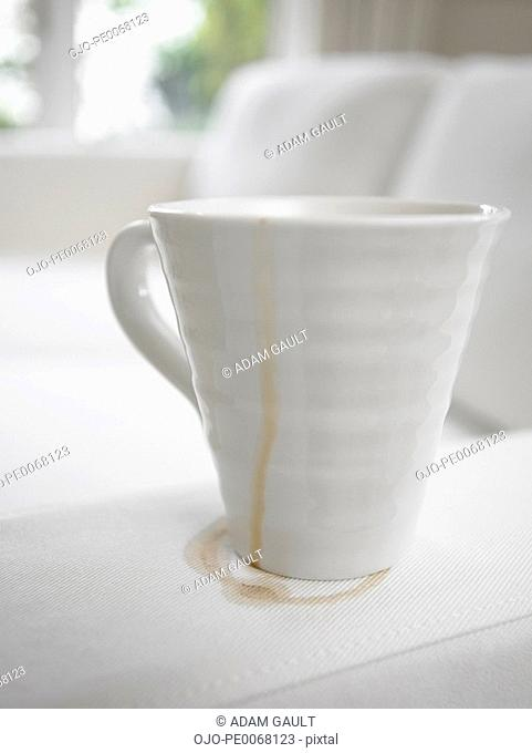 Close up of coffee cup making stain on sofa