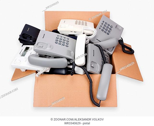 VILNIUS, LITHUANIA - JANUARY 25, 2016: A cardboard box with Panasonic cheap phones which are prepared for utilization and processing