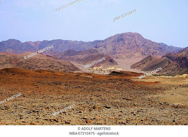 Rocky mountain landscape with marlstones deposits on the Hoarusib River
