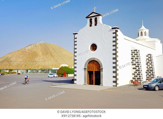 Church of Ermita de los Dolores in village of Mancha Blanca. Lanzarote, Canary Islands. Volcanic cone of Montana Tinache behind
