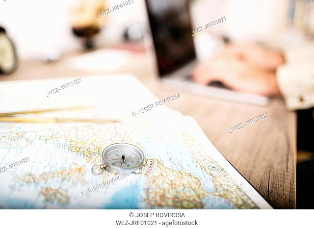 Man sitting at his desk planning his next journey