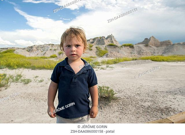 Little boy at Badlands National Park, South Dakota, USA