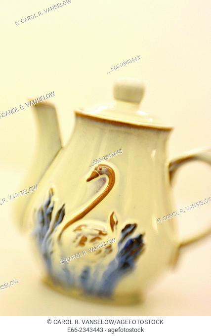 White ceramic teapot with swan design