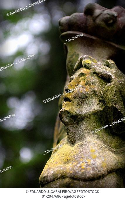 Figure of a gargoyle in the gardens of Alcazar of Seville