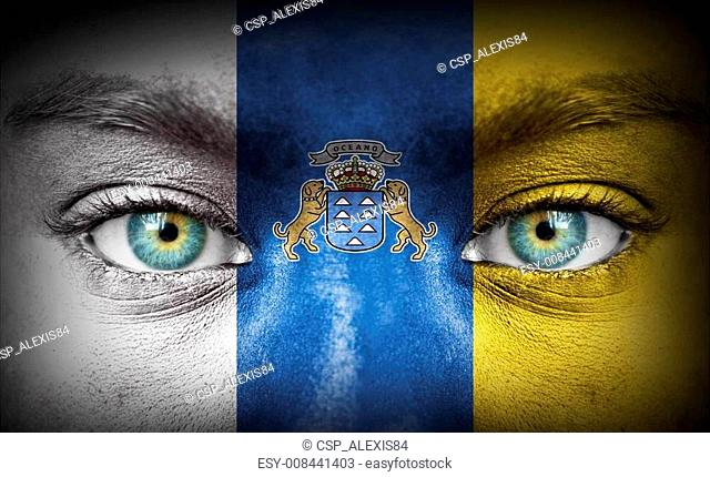 Human face painted with flag of Canary Islands