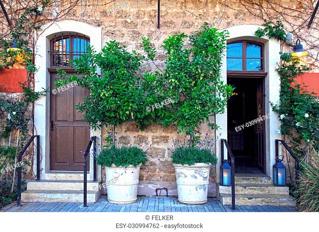 Doors, plants and flowers in a traditional stone mediterranean house