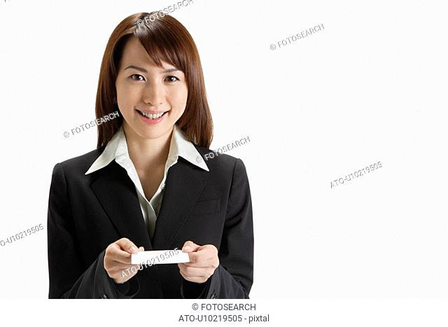 Cheerful executive holding a paper, portrait