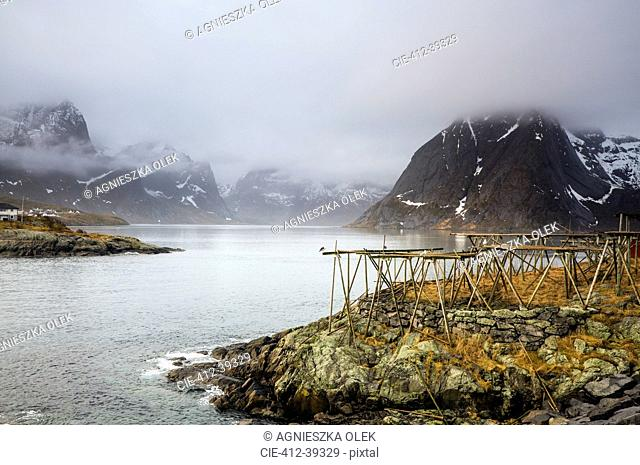 Foggy, cold rugged mountains and river, Hamnoya, Lofoten, Norway