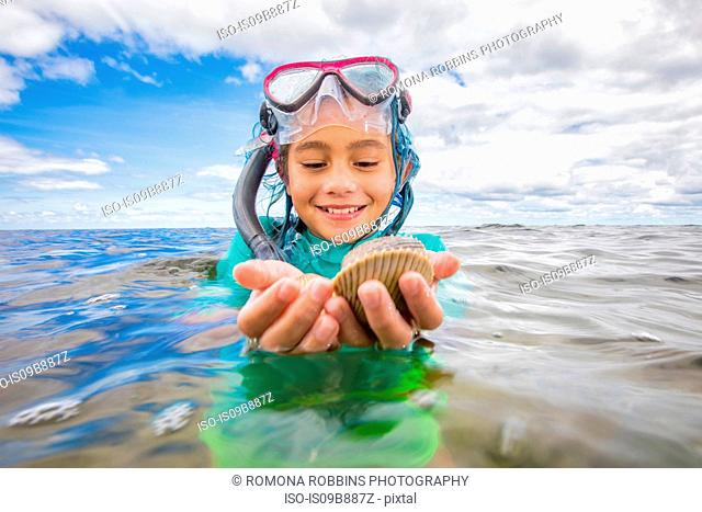 Girl holding fresh caught scallops