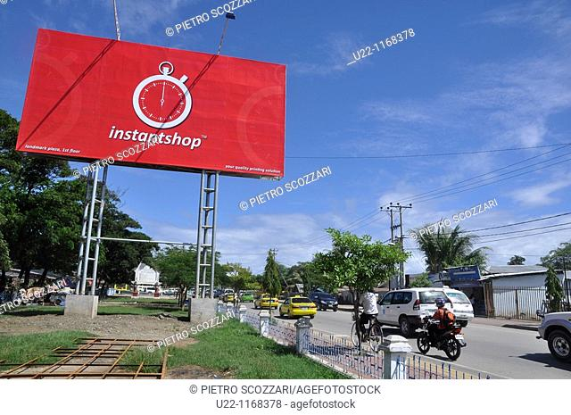 Dili (East Timor): a big outdoor ad along the main road to the airport