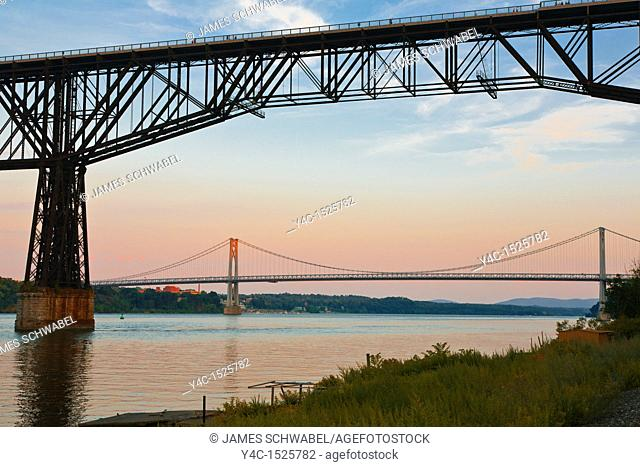 Walkway Over the Hudson State Historic Park footbridge across the Hudson River between Poughkeepsie and Highland New York with the Mid-Hudson Bridge in the...