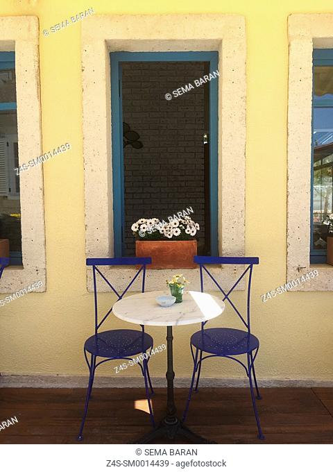 Two chairs waiting for guests at the cafe in Alacati town, the historic centre of Zeytineli Koeyue, Cesme, Izmir, Aegean Coast, Turkey, Europe