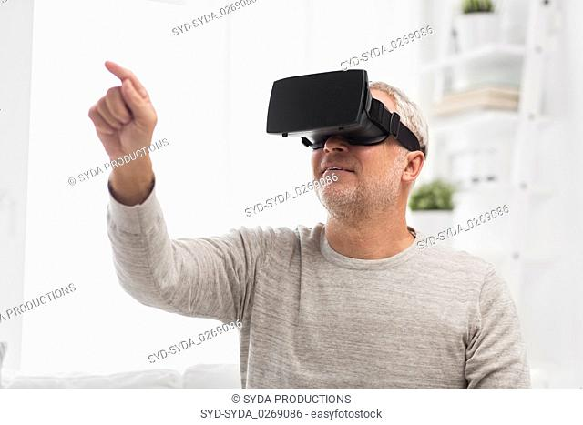 old man in virtual reality headset or 3d glasses