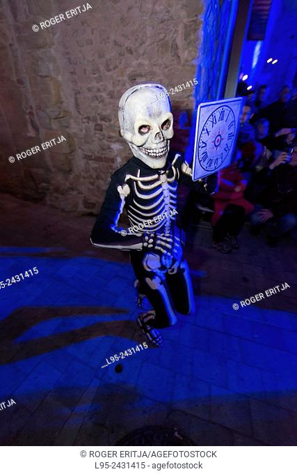 Dancing skeletons reminding the crowd about shorness of life. This is the main scene of the Dance of the Dead in Verges, Spain