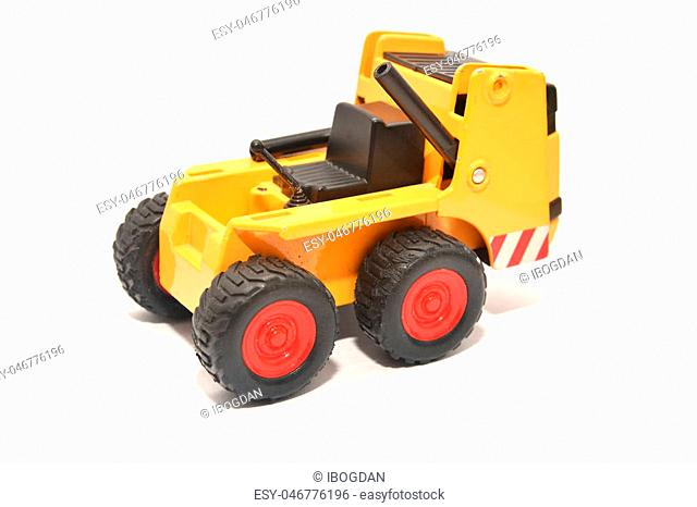 a miniature toy bulldozer isolated on white
