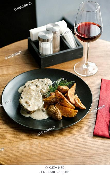 Pork tenderloin with mushroom sauce and potatoes