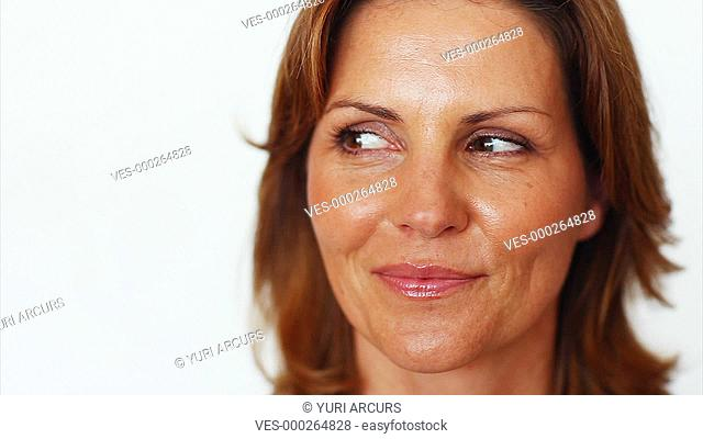 Closeup of a pretty mature woman looking away and smiling