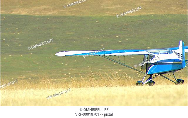WS Light aircraft moving through grass / Howick, KwaZulu-Natal Province, South Africa
