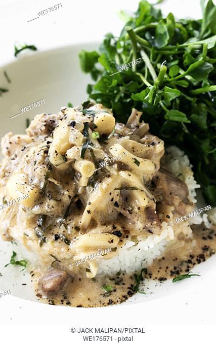 Pork Stroganoff with mushroom cream and paprika sauce gourmet meal in restaurant