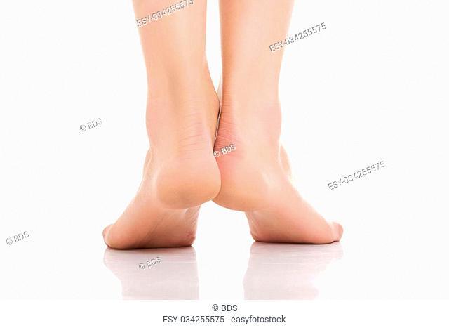 Female beautiful slim nude feet