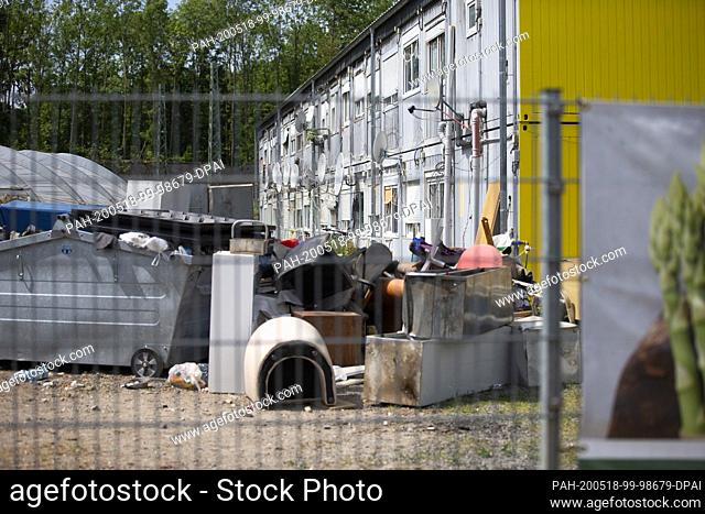18 May 2020, North Rhine-Westphalia, Bornheim: Rubbish and junk piles up in front of the accommodation for harvest workers at the Ritter asparagus farm