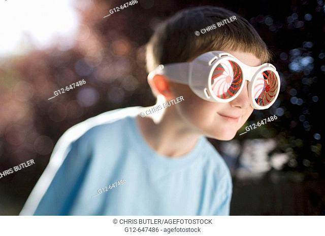 Boy, age 7, wearing big sunglasses