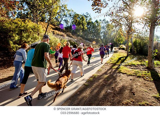 Participants in a fund raising charity walk for Alzheimer's victims take their pets with them in a Laguna Niguel, CA, park