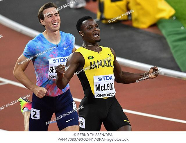 Jamaican athlete Omar McLeod (R) celebrates his victory in the 110 metre men's hurdle jump event at the IAAF London 2017 World Athletics Championships in London
