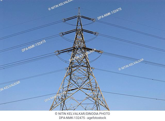 High tension line tower top portion and Greenery ; Electric Energy ; Kalyan ; District Thane ; Maharashtra ; India
