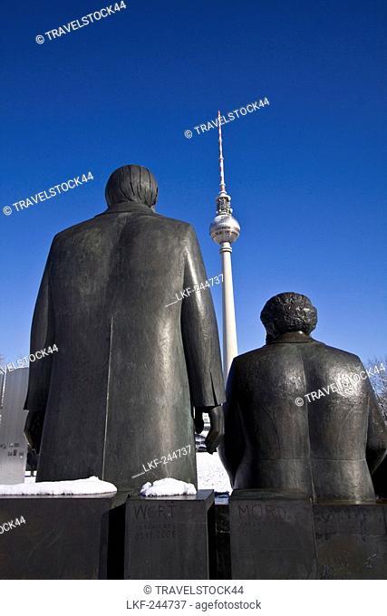 Snow landscape at Marx and Engels sculpture, background Alex, Berlin center