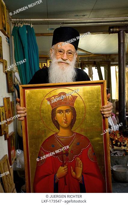 Icon painter Father Kallinikos holding a painting, icon, Stravrovouni monastery, Larnaka, South Cyprus, Cyprus