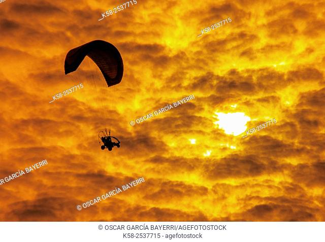 Motor gliders or paragliders flying in the golden coast near the village population Montsià, Tarragona, Catalonia