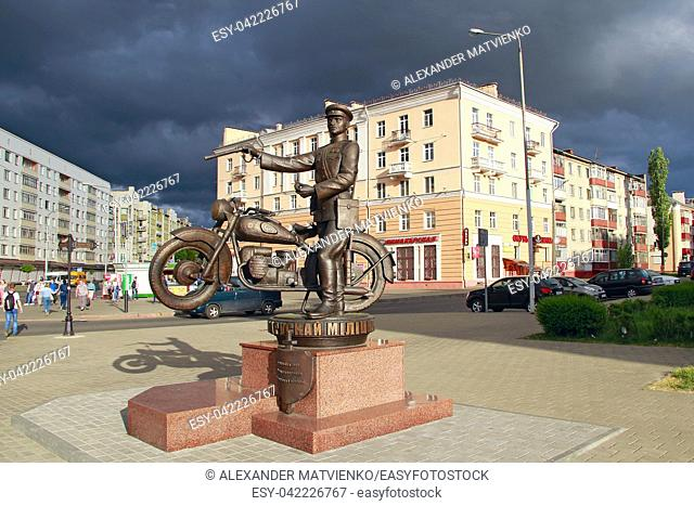 Monument to Belarusian policemen against backdrop of thundercloud. It's going to rain in city. Monument to policeman in city of Gomel