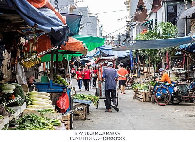 Chinese food market stalls selling vegetables in Glodok, also known as Pecinan or Chinatown in the city Jakarta, Indonesia
