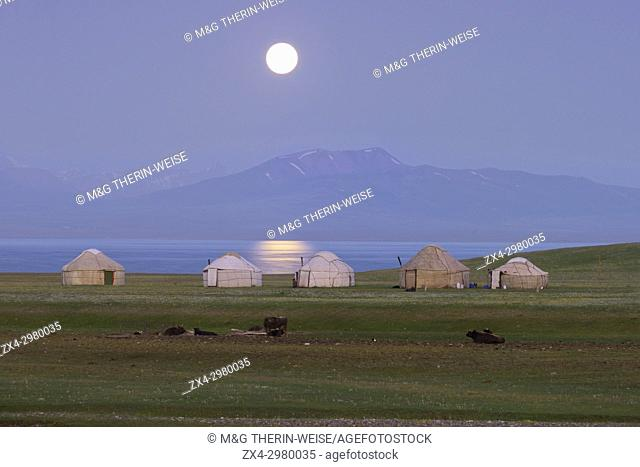 Moon rising over Song Kol lake and nomads Yurts, Naryn province, Kyrgyzstan, Central Asia