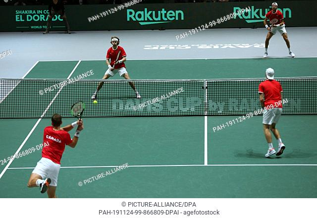 19 November 2019, Spain, Madrid: The tennis player Karen Khachanov and Andrey Rublev from Russia play versus Vasek Pospisil and Denis Shapovalov from Canada for...