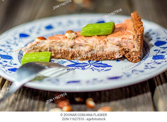 Slice of freshly baked rhubarb pie on a plate