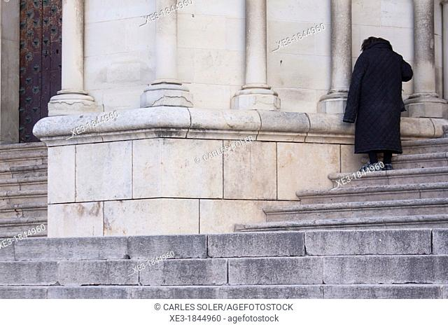 Beggar on the steps of the Cathedral, Cuenca, Castile-La Mancha, Spain