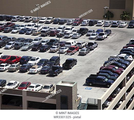 Cars parked on rooftop parking structure