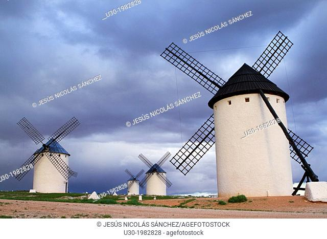 Typical windmills at sunset in Campo de Criptana village, in the Route of Don Quiijote, Ciudad Real province, Castilla-La Mancha, Spain