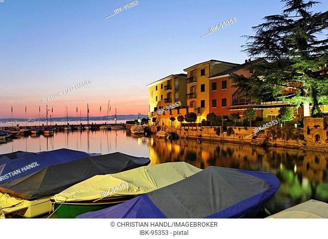 Small harbour and hotels at dusk in Sirmione, Lake Garda, Italy