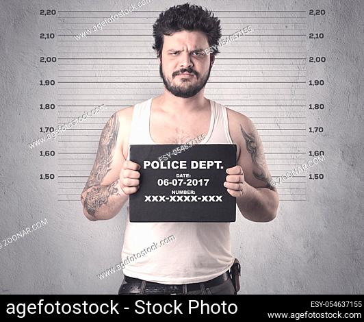 Caught gangster in jail with table on his hand