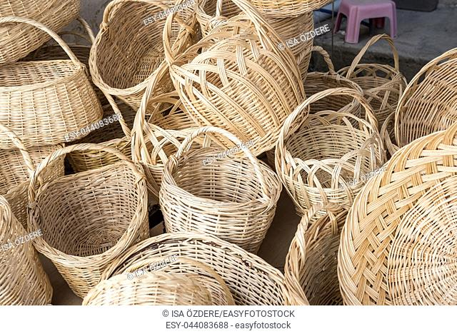 Many wooden hampers ,wickers,are sale on stall in Tarakli,Turkey