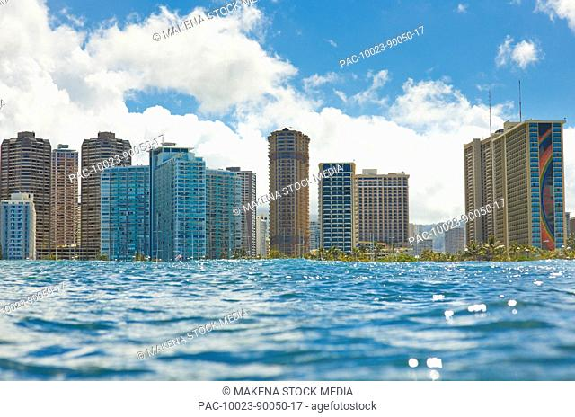 Hawaii, Oahu, Waikiki, View of tall buildings from ocean