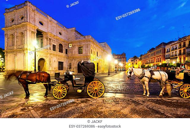 Horse carriages near City hall in early morning at Seville. Andalusia, Spain