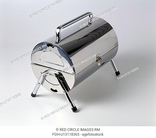 Close-up of closed fold-up portable stainless-steel barbeque