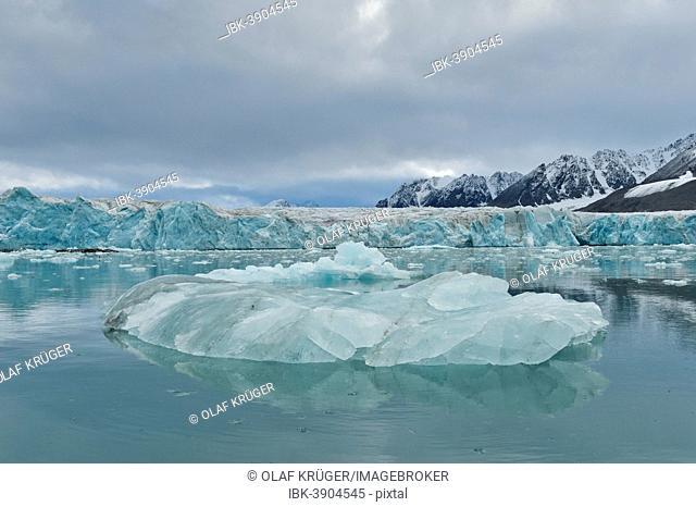 An iceberg and the escarpment of the glacier, Monacobreen glacier, Liefdefjorden fjord, Spitsbergen, Svalbard Islands, Svalbard and Jan Mayen, Norway
