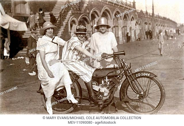 Three ladies pose for a photograph on a 1908 Phelon & Moore 500cc 2 stroke motorcycle on Brighton Parade circa 1910