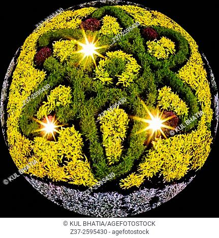 Three ellipses. A topiary traces the elliptical track of an atom, Ontario, Canada