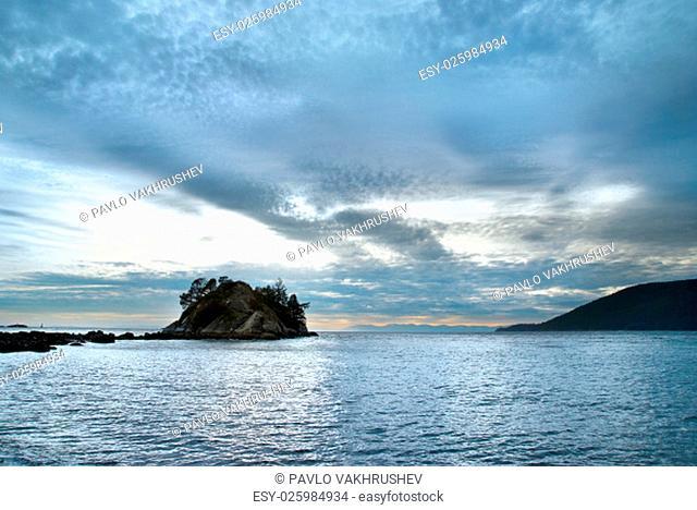 Island in the sea near coast. North Vancouver